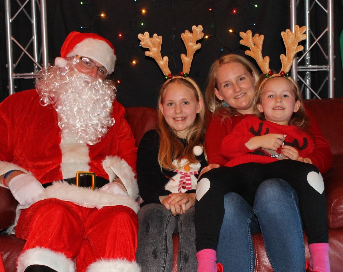 One of our GOSS families meeting Santa